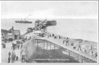 Pier and paddle steamer.